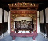 Exquisitely carved traditional bed with gold gilded images, Lu´s Residence, Dongyang, Jinhua, Zhejiang Province, China