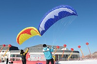 Two men testing parachute, Beidahu Ski Resort, Jilin, Jilin Province, China