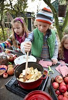Children making apple sauce