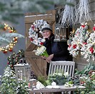 Woman making christmas arrangement