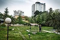 Policeman in a garden, Tirana, Albania.