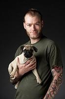Man, dog, pug, wear, studio, half portrait,