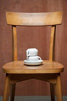 Cups, plates, turned, on top of each other, chair,