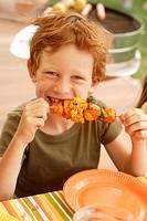 Child, boy, grill skewer, eating, summer, outside, portrait,