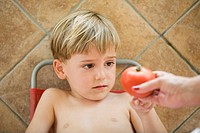 Child, boy, woman, look, detail, hand, tomato, refuse, offer,