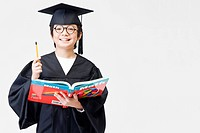 Boy in graduation gown (thumbnail)