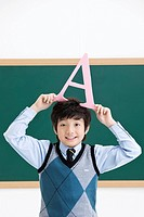 Boy in front of blackboard (thumbnail)