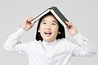 Girl holding a book (thumbnail)