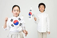 Boy and girl holing Korean flag, Taegeukgi (thumbnail)