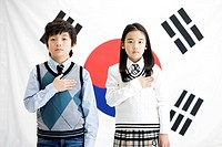 boy and girl in front of Korean flag, Taegeukgi