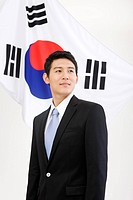 Businessman in front of Korean flag, Taegeukgi (thumbnail)