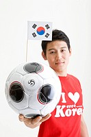 man holing soccer ball and Korean flag, Taegeukgi