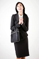 Businesswoman holding a briefcase (thumbnail)