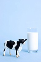 glass of milk and animal shape, cow