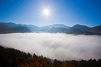 Sea of clouds sitting in a mountain valley in autumn. Godaido, Yamagata Prefecture, Japan