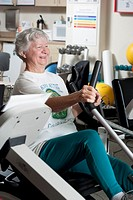 Female heart patient exercising in hospital cardiac rehab fitness center