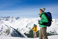 Couple backpacking on snowy mountain
