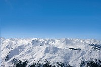 View of snowy mountain range and blue sky