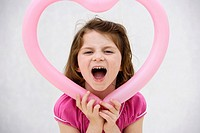 Young girl holding heart