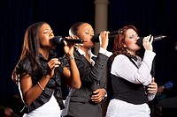Fort Lauderdale, Florida, United States Of America, Three Women Singing Into Microphones