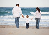Fort Lauderdale, Florida, United States Of America, A Family Walking On The Beach By The Ocean
