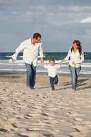 Fort Lauderdale, Florida, United States Of America, A Family Running On The Beach
