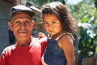 Guatemala City, Guatemala, A Man Holding A Young Girl