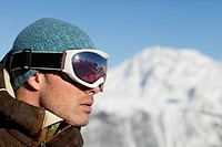 Portrait of man with ski goggles, profile