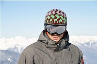 Portrait of young man with ski goggles