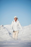 Young woman walking in snow