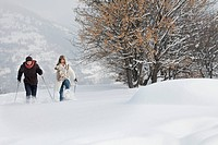 Young couple snowshoeing
