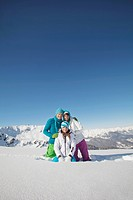 Couple and daughter in ski wear, smiling at camera