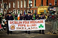 Dublin, Ireland, Men Holding A Sign ´dublin Fire Brigade Pipe Band Ireland´ As They Go Down O´connell Street