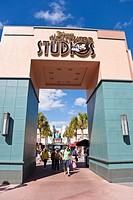 Orlando, FL - Feb 2009 - Park visitors walk under Disney's Hollywood Studios sign above walkway at Hollywood Studios theme park in Kissimmee Orlando F...