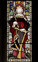 A stained glass window depicting King David with a harp, St Peter and St Paul Church, Wing, Rutland