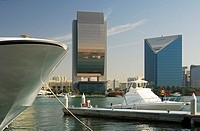Yachts and modern architecture on the banks of the Dubai Creek, buildings of the National Bank of Dubai, NBD, and the Dubai Chamber of Commerce and In...
