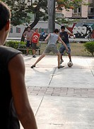 Young Cubans play football in a park with some Revolution Icons in the backgroundon, in Havana, Cuba