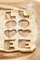 Biscuit dough with the word ´LOVE´ cut out twice