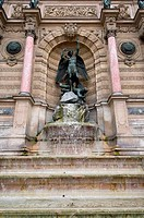 Statue at a fountain, Fontaine Saint_Michel, Place Saint_Michel, Latin Quarter, Paris, Ile_de_France, France