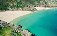 Sunbathers on the white sandy beach at Porthcurno Bay in Cornwall, England UK United Kingdom