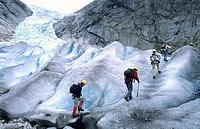 Tourists climb up Nigardsbreen glacier National Park of Jostedalbreen Norway