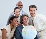 Multi_ethnic businessteam holding a globe in the office of the company