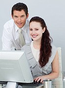 Businessman and businesswoman using a computer in the office