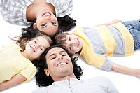 Cute family lying on the floor together at home
