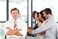 Senior leadership with crossed arms working in a call center