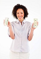 Smiling brunette businesswoman holding dollars in her hands