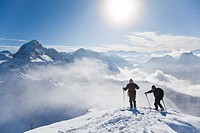 Two ski mountaineers on a mountain peak, Salzburger Land, Austria, elevated view