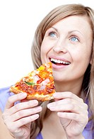 Cheerful woman holding a pizza against a white background