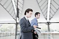Businessman text messaging on cell phone (thumbnail)