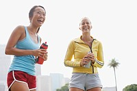 Women laughing and holding water bottles (thumbnail)